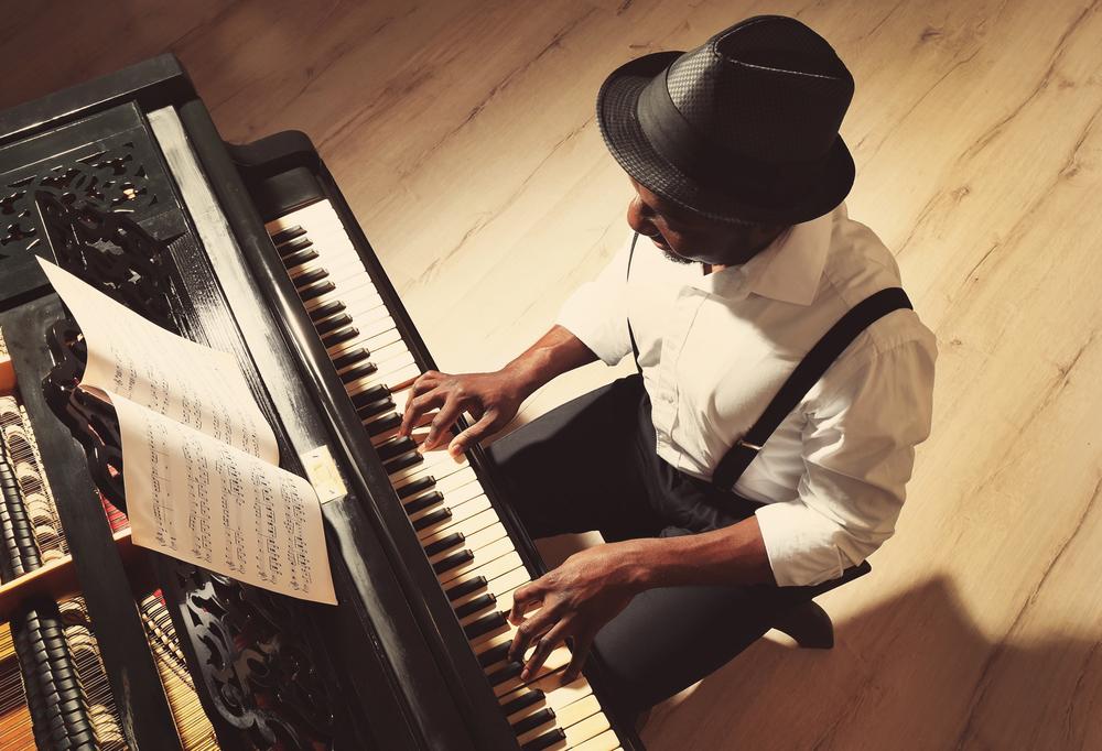Man playing piano celebrating ballroom dancing and jazz music