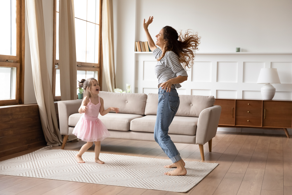 Mom and Daughter dancing for Mother's Day