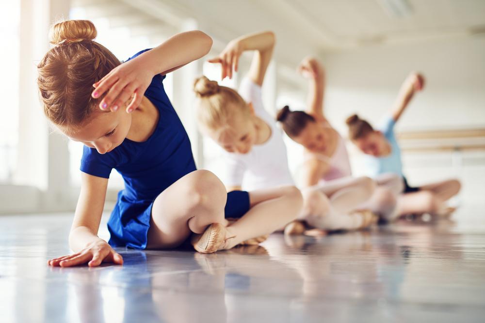 Kids doing ballet in a dance studio