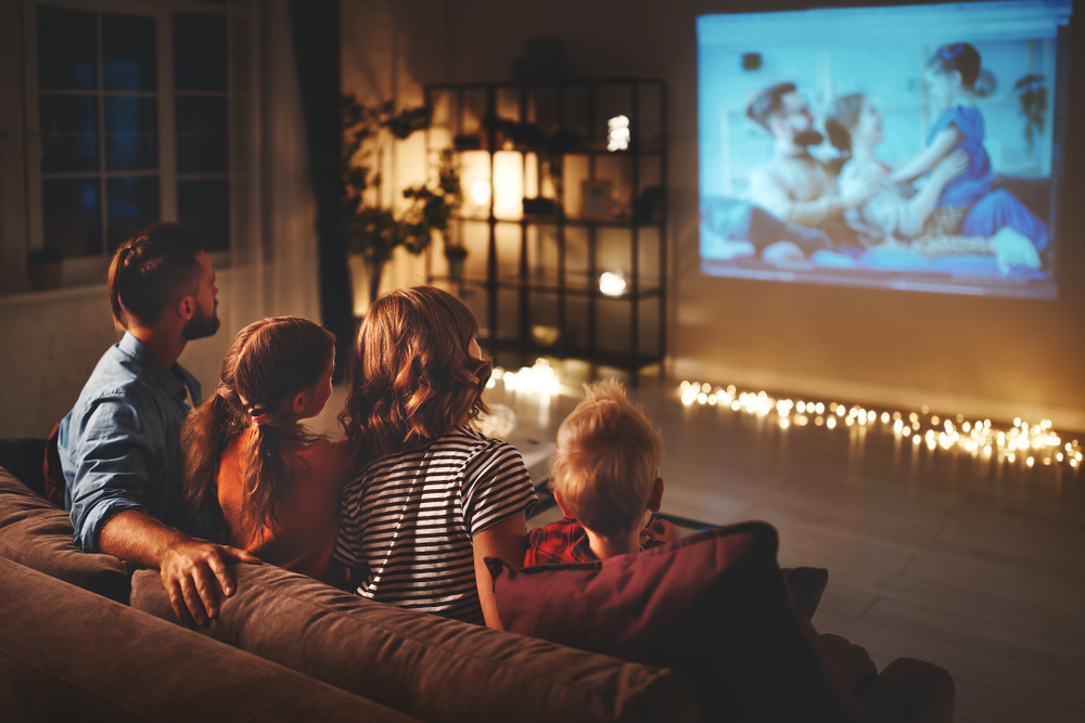 Family watching dance movies together on couch