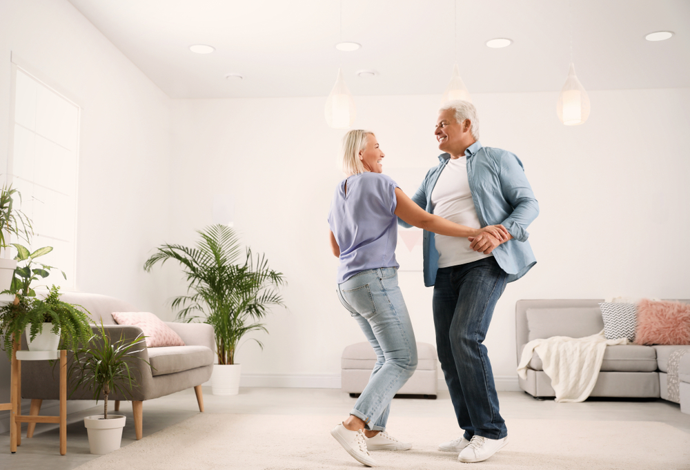 Older couple dancing as one of the indoor exercises