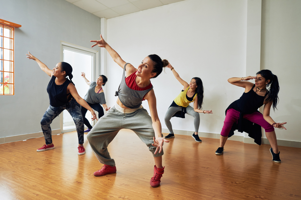 Group of people trying a hip hop type of dance